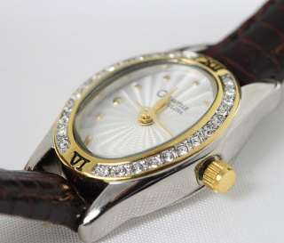 Caravelle by Bulova Ladies Crystal Accented White Dial Brown Leather