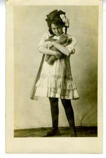 1920 RPPC Postcard Girl hugging Teddy Bear