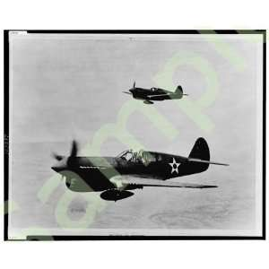 1943 Curtiss P 40 Warhawk SE fighter planes in flight
