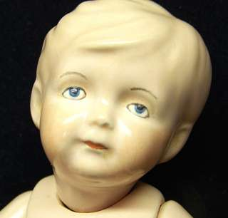 Molded hair, intaglio blue eyes, hand painted, and fully jointed