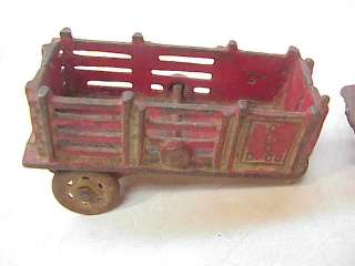 ANTIQUE AC WILLIAMS CAST IRON TRUCK STAKE TRAILER toy