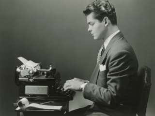 Man Using Typewriter, Side View Photographic Print by George Marks at