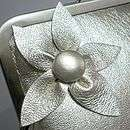 metallic leather flower clutch bag by caramel designs