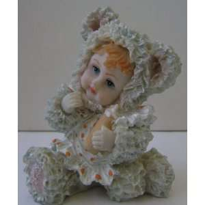 Ceramic Poly Baby in Teddy Bear Costume Figurine   3 1/2